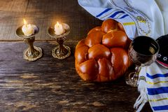 Shabbat eve table candles and cup of wine with covered challah bread. Shabbat eve table with covered challah bread, candles and cup of wine jewish sabbath stock photos