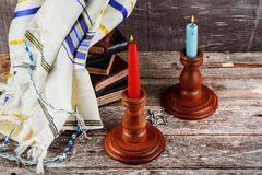 Shabbat eve table with covered candles. Shabbat eve table with covered challah bread, candles Royalty Free Stock Photos