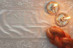 Shabbat image. challah bread and candles Stock Photos