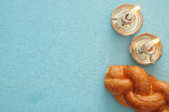 Shabbat image. challah bread and candles. Top view Stock Images