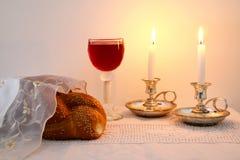 Shabbat image. challah bread, shabbat wine and candelas Stock Photos