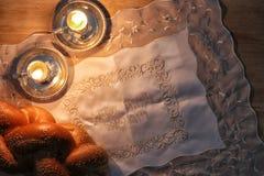 Shabbat image. challah bread, shabbat wine and candelas Stock Photo