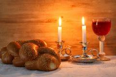 Shabbat image. challah bread, shabbat wine and candles Stock Image