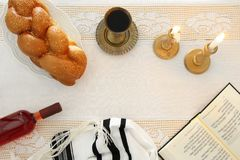 Shabbat image. challah bread, shabbat wine and candles on the table. Top view. Shabbat image. challah bread, shabbat wine and candles on the table. Top view Stock Photos