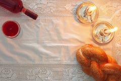 Shabbat image. challah bread, shabbat wine and candles Royalty Free Stock Image