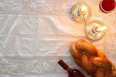 Shabbat image. challah bread, shabbat wine and candles Royalty Free Stock Photos