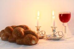 Shabbat image. challah bread, shabbat wine and candles Royalty Free Stock Photo