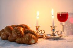 Shabbat image. challah bread, shabbat wine and candles Stock Photography
