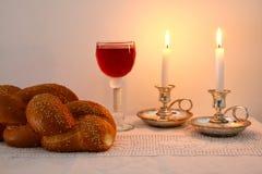 Shabbat image. challah bread, shabbat wine and candles Stock Images