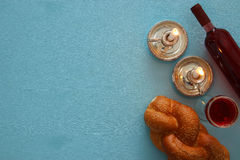 Shabbat image. challah bread, wine and candles. Top view.  Royalty Free Stock Image