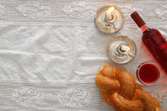 Shabbat image. challah bread, wine and candles. Top view Stock Photos