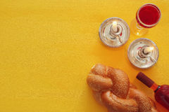 Shabbat image. challah bread, wine and candles. Top view.  Royalty Free Stock Photography