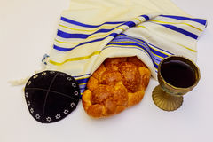 Shabbat with lighted candles, challah bread and wine. Royalty Free Stock Photography