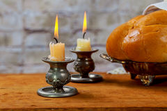 Shabbat with lighted candles, challah bread and wine. Royalty Free Stock Images