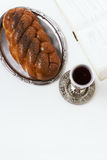Shabbat Shalom, challah with glass of wine on a white background. Not isolated, copy space, author processing. Stock Photos