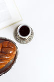 Shabbat shalom, challah with kiddush of wine on a white background. Not isolated, copy space, author processing. Stock Photos