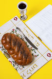Shabbat shalom, challah on napkin with Kiddush and book on yellow background. Copy space, author`s processing. Royalty Free Stock Photos