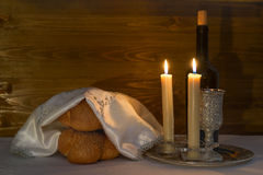 Shabbat Shalom - wine, challah and candles Stock Photography