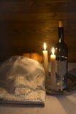 Shabbat Shalom - wine, challah and candles Royalty Free Stock Image