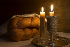 Shabbat Shalom - wine, challah and candles. Shabbat Shalom - Traditional Jewish Sabbath ritual Royalty Free Stock Photography