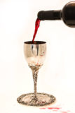 Shabbats wine in the cup. Filling ritual wine cup in the Sabbath Royalty Free Stock Image
