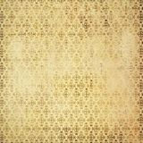 Shabby aged parchment background with geometric baroque patterns. Shabby aged golden pink parchment background with geometric baroque patterns and attritions stock illustration