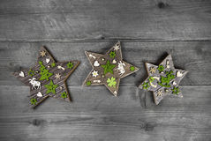 Shabby And Vintage Apple Green And Grey Wooden Christmas Decoration With The Stars. Royalty Free Stock Images