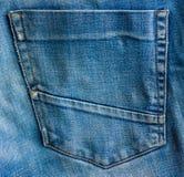 Shabby back pocket. Back pocket close-up of denim Stock Image