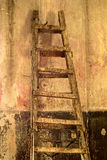 Shabby background with a ladder in the room with the old walls. Royalty Free Stock Photos