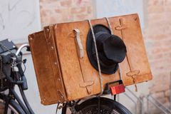 Shabby Black Hat and Brown Suitcase. Royalty Free Stock Photo