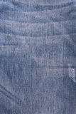 Shabby blue jeans texture crumpled Stock Images