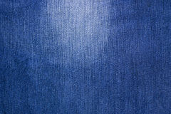 Shabby blue jeans texture. Natural denim Royalty Free Stock Images