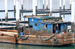 Shabby boat working at dock. Shown as special working environment and area, featured of construction industry Royalty Free Stock Photography