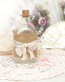 Shabby bottle and hand fan. Shabby bottle and hand  fan Royalty Free Stock Image