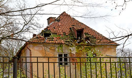 The shabby building with the destroyed tile roof Stock Photography