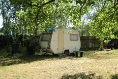 Shabby caravan in the campsite Stock Photo