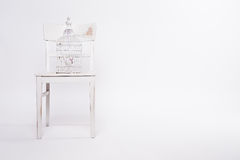 Shabby chair with birdcage Stock Photography