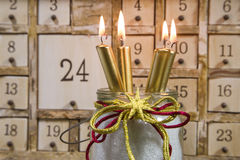 Shabby chic advents calendar with four gold burning candles Stock Images