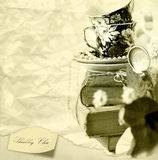 Shabby chic background. Romantic Shabby chic background with Old Books , pocket watch and cups Stock Photos