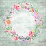 Shabby Chic Background with Floral Wreath. Vintage grunge card template with painted wood background and round watercolor summer frame border Royalty Free Stock Image