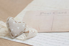 Shabby chic background. Shabby chic heart on vintage papers Stock Photos