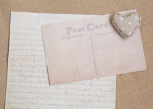 Shabby chic background. Shabby chic heart on vintage papers Stock Photo