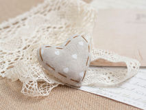 Shabby chic background. Shabby chic heart on vintage papers Royalty Free Stock Photo