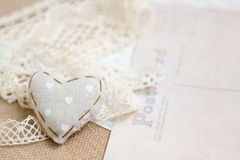 Shabby chic background. Shabby chic heart on vintage papers Stock Images