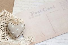 Shabby chic background. Shabby chic heart on vintage papers Stock Photography