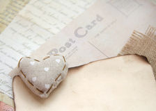 Shabby chic background. Shabby chic heart on vintage papers Royalty Free Stock Image