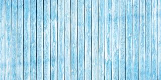 Shabby chic background of old wooden planks painted in soft blue. Old wooden planks painted in soft blue color. Shabby chic background royalty free stock photos