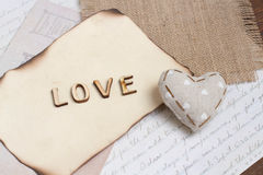 Shabby chic background. Word love on vintage papers Stock Images