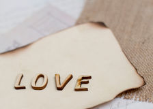 Shabby chic background. Word love on vintage papers Stock Photo