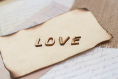 Shabby chic background. Word love on vintage papers Stock Image